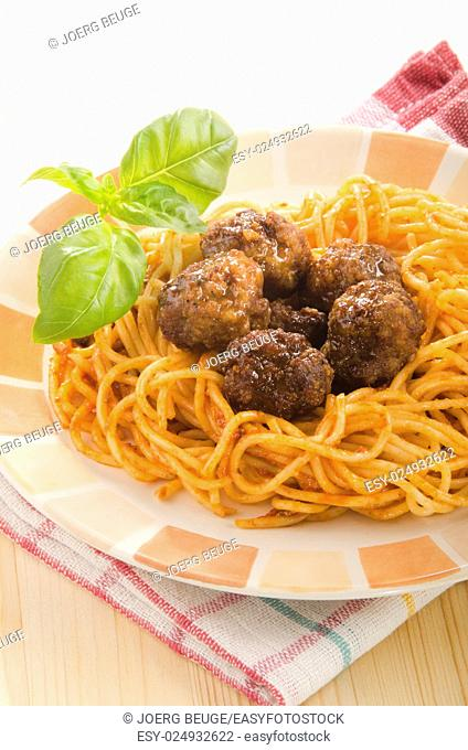 meat balls with spaghetti, basil and tomato sauce