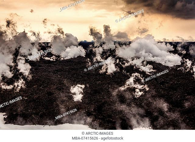 Hot lava steaming. Eruption site at Holuhraun near Bardarbunga Volcano, Iceland. August 29, 2014 a fissure eruption started in Holuhraun at the northern end of...