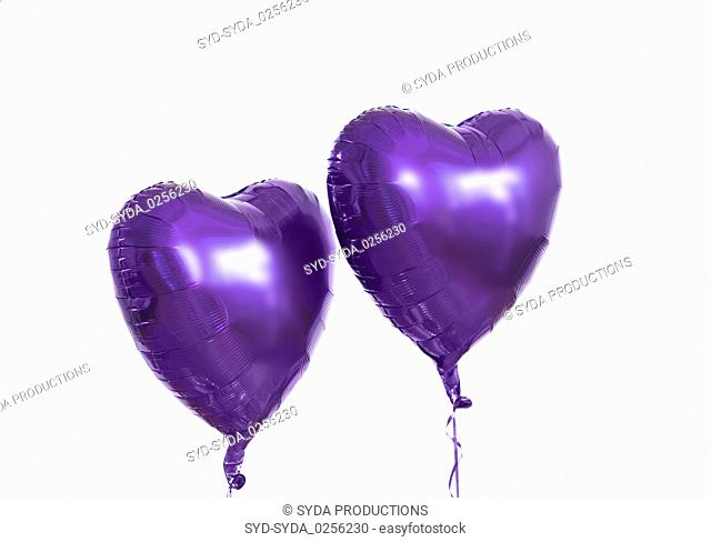 close up of helium balloons over white background