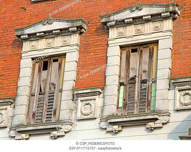 balconies and wooden fixtures ruined and destroyed of an ancient