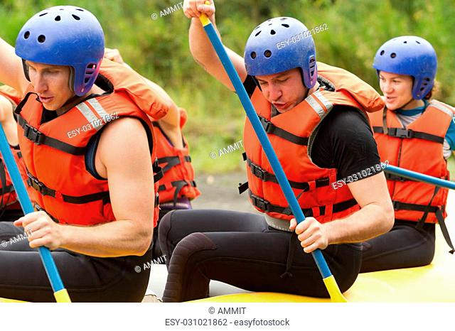 Group Of Young Athletes Training For Whitewater Rafting