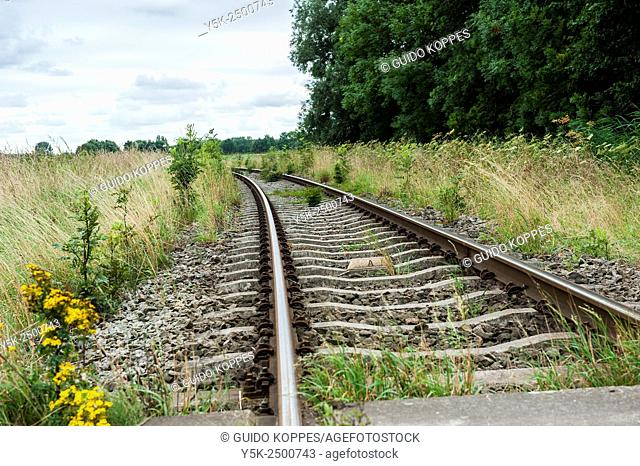 Klaverpolder, Netherlands. Single railroad track for freight trains through a polder, leading towards an industrial estate