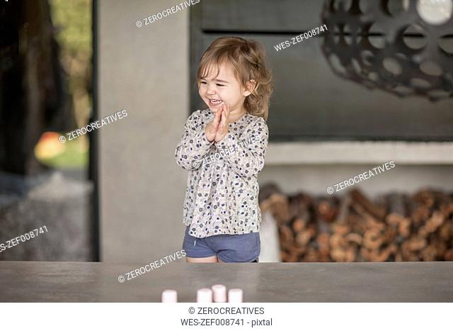 Happy little girl clapping hands