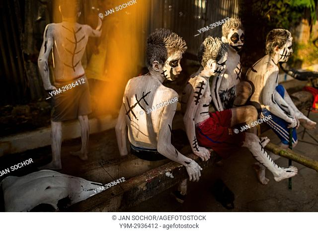 Salvadoran boys, having white body paint with black symbols, perform during the La Calabiuza parade at the Day of the Dead festivity in Tonacatepeque