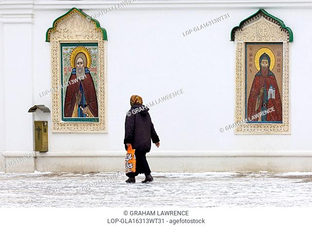Russia, Moscow Oblast, Moscow. A view of icons in the courtyard of Danilov Monastery at Zamoskovoreche