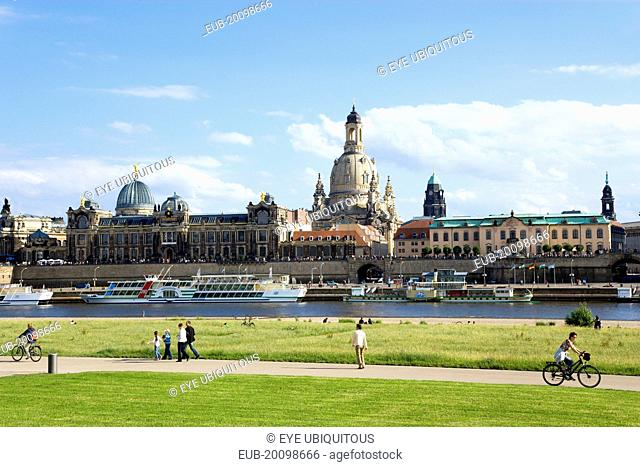 The city skyline with cruise boats moored on the River Elbe in front of the embankment buildings on the Bruhl Terrace busy with tourists of the Art Academy the...