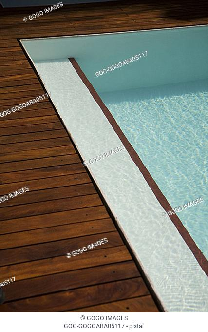 Wooden deck and swimming swimming pool