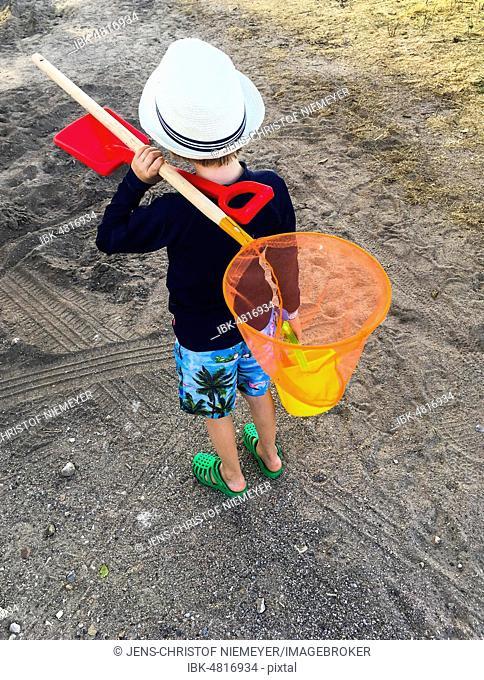 Boy with a fishing net on the beach, Denmark