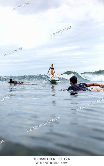 Indonesia, Java, surfers in the ocean