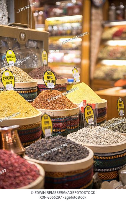 In market stall in front of store at the Istanbul Spice bazaar, in Turkey, are stocked baskets full of savory spices on display for sale