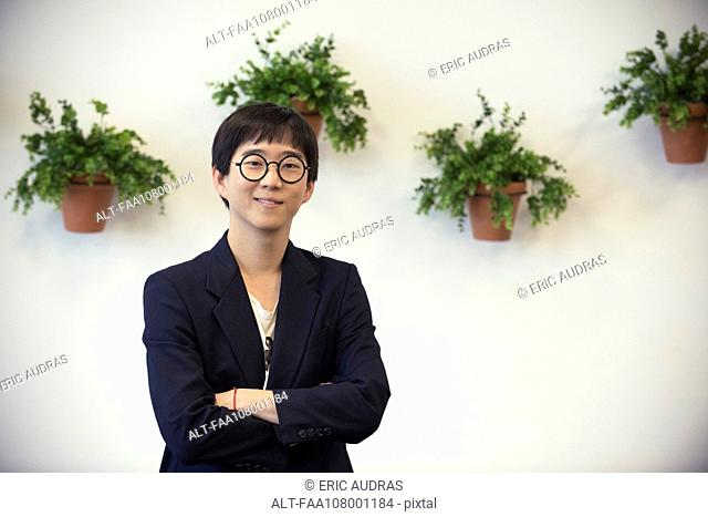 Male entrepreneur smiling cheerfully, portrait