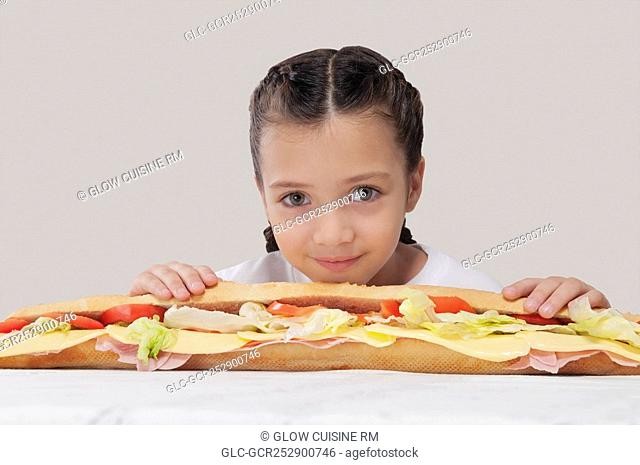 Portrait of a girl with a submarine sandwich