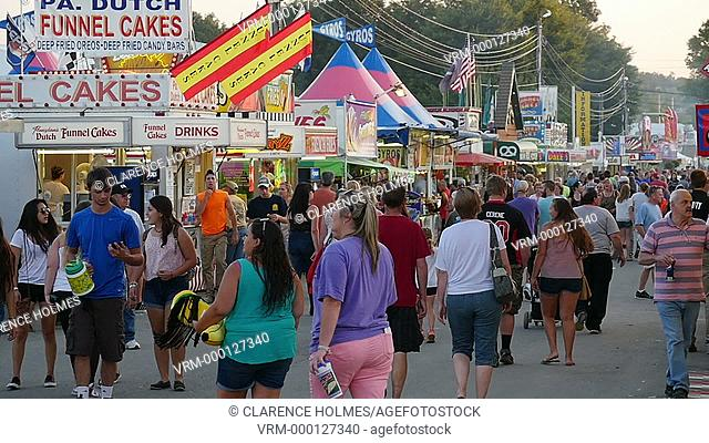 AUGUSTA, NJ - AUGUST 6: (Slow Motion) People walk on the midway during the New Jersey State Fair on August 6, 2014 at the Sussex County Fairgrounds in Augusta