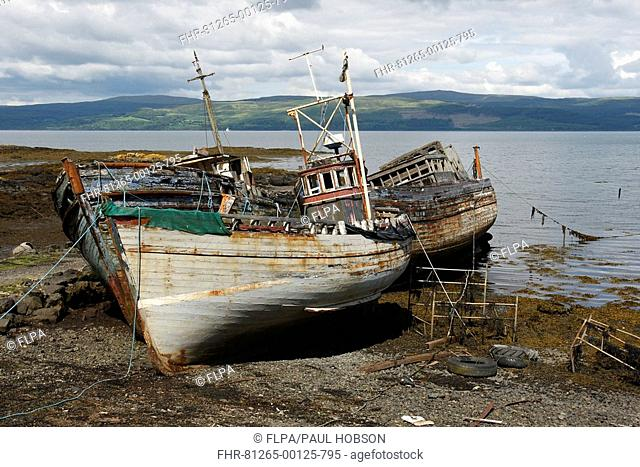 Abandoned trawlers, beached on shore, Salen Bay, Isle of Mull, Inner Hebrides, Scotland
