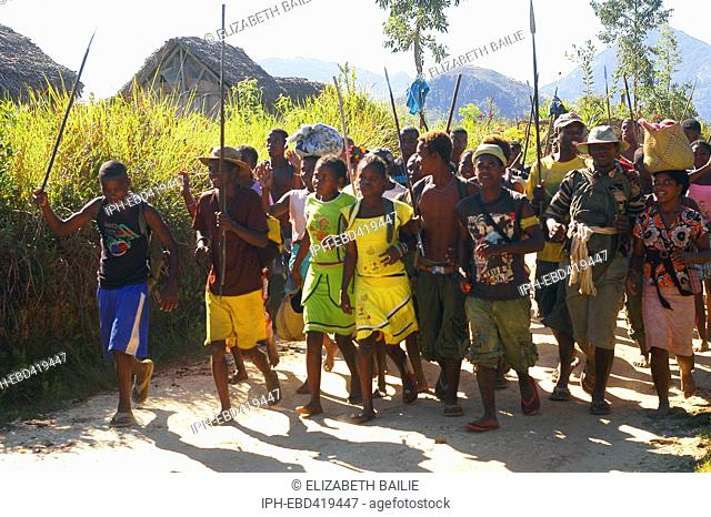 Madagascar Anosy region A group of people run to a seasonal friendly wrestling match to celebrate the end of the harvest
