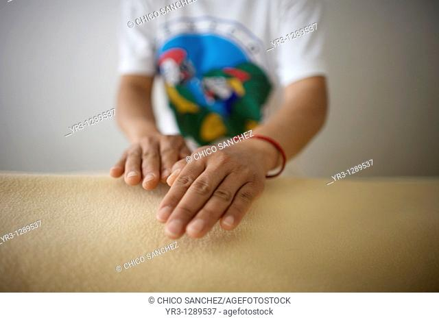 A student gives Reiki using her hands in Mexico City, September 12, 2010  Reiki is a spiritual practice developed in 1922 by Japanese Buddhist Mikao Usui  It...