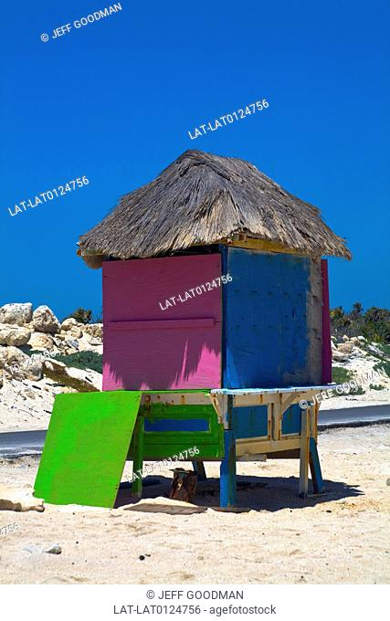The coastline of Quintana Roo has large resorts such as Cozumel and there are small brightly painted beach huts selling food and drinks to the tourist