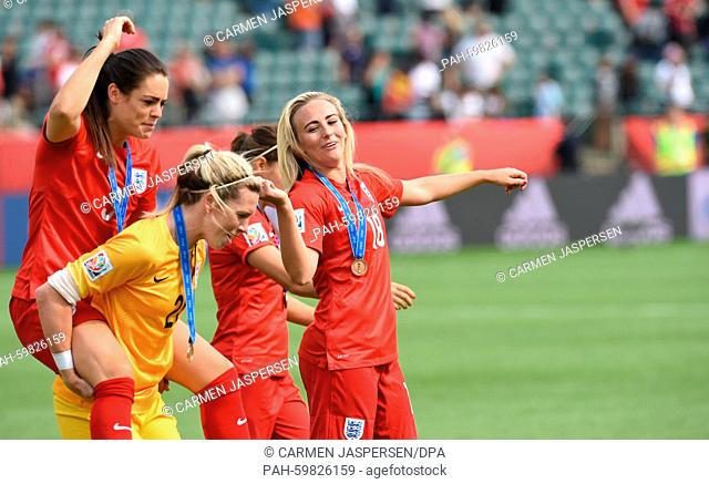 England's (L-R) , goalkeeper Carly Telford Claire Rafferty, Karen Carney and Toni Duggan celebrate there victory after the FIFA Women's World Cup 2015 third...