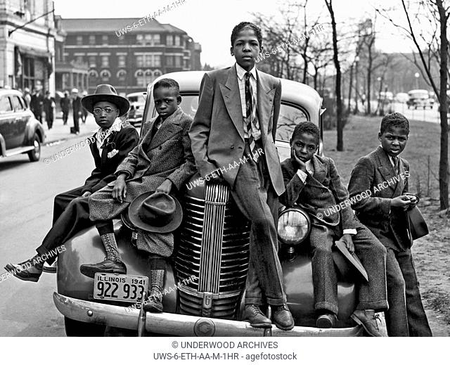 Chicago, Illinois: April 1941 .African American boys on the Southside of Chicago on Easter morning