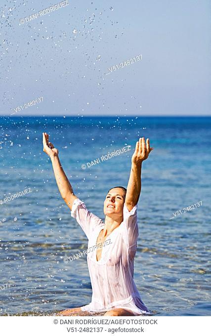 Brunette beautiful woman enjoying bath at the sea
