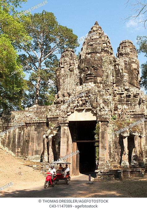 Cambodia - Tuk-tuk at the inner side of the Victory Gate of Angkor Thom, the 'Great Capital' of the Khmer empire in Angkor