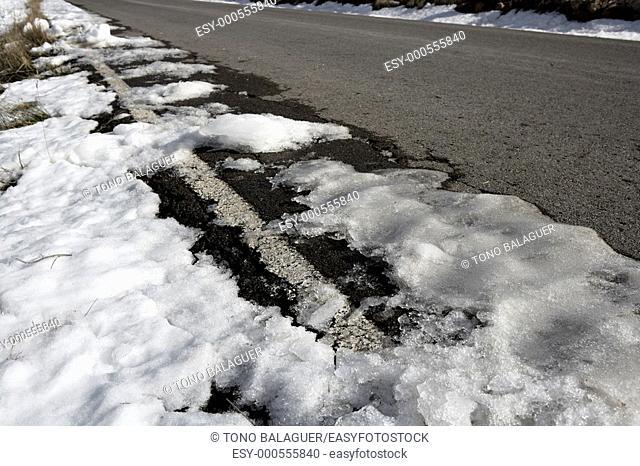 snow on asphalt road hide the white lines
