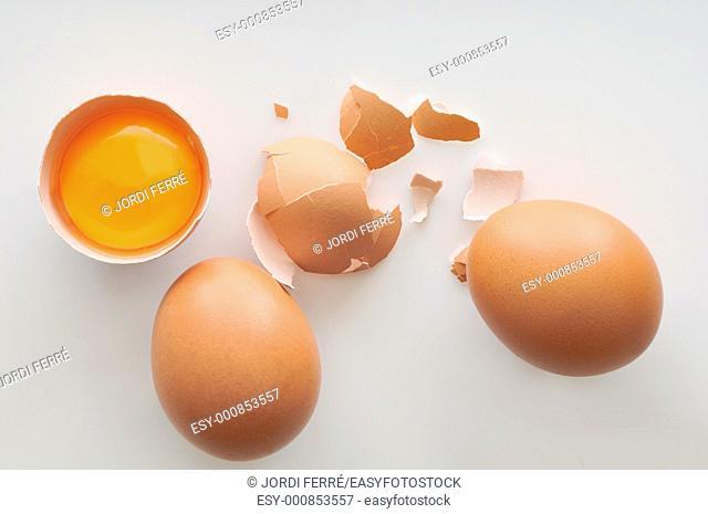 Egg yolk and shells on white background