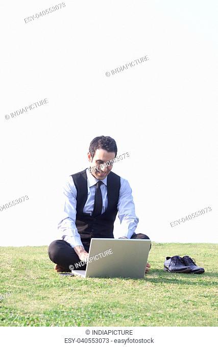 Businessman working on a laptop , INDIA , DELHI