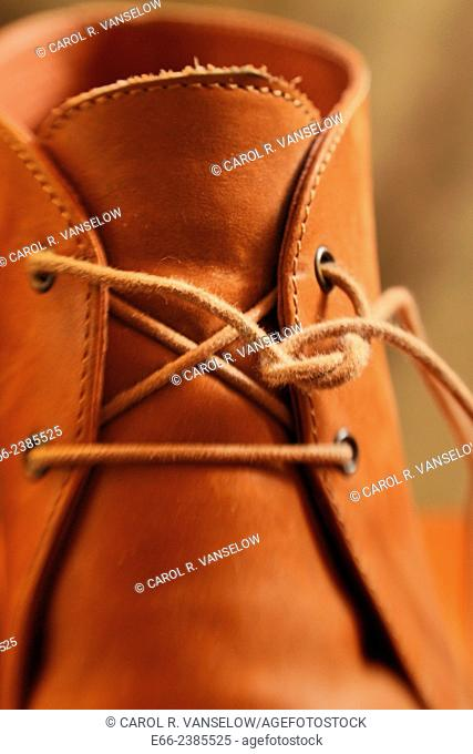 pair of women's boots with laces undone