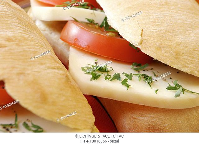 Two garnished sandwiches