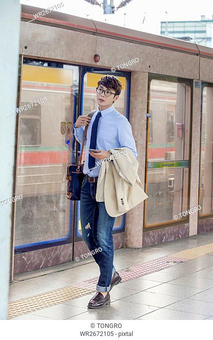 Businessman at subway station