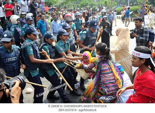 DHAKA, BANGLADESH - MARCH 30 : Police force charges to disperse protesting nurses in Dhaka, Bangladesh on March 30, 2016