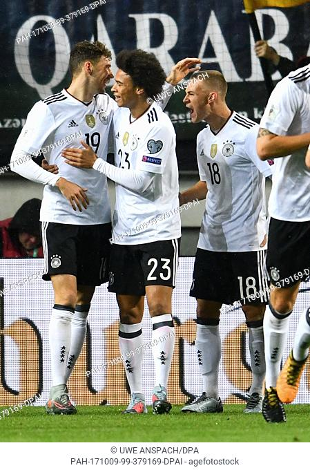 Germany's Leon Goretzka (left to right) celebrating with Leroy Sane and Joshua Kimmich his scoring of the opener during the World Cup Group C soccer qualifier...