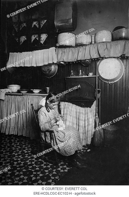 Child labor, original caption: 'Carmela Picciano, 311 E. 149th Street, 3rd floor rear. 12 years old. Making Irish lace for collars. Works until 9 P.M