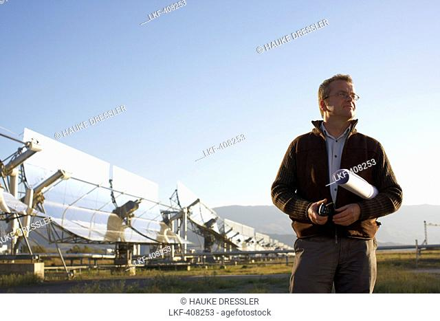 Engineer Dr. Christoph Richter (chief of DLR) in front of parabolic trough solar collectors, PSA, Plataforma Solar de Almeria