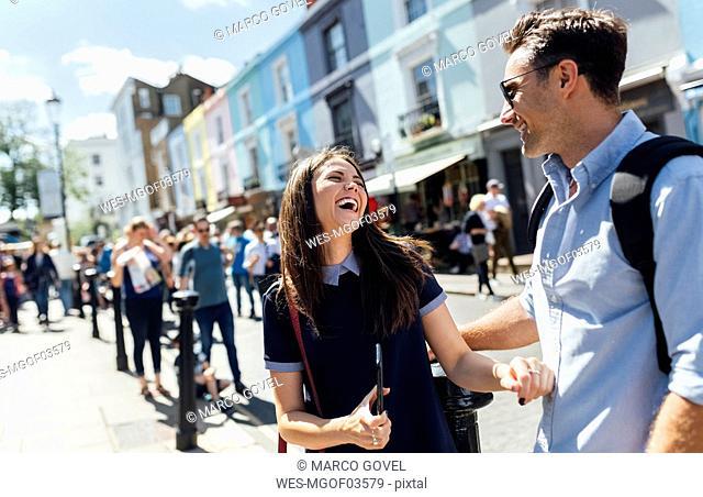 UK, London, Portobello Road, couple having fun