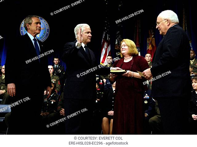Robert Gates is sworn in as the 22nd Secretary of Defense by VP Cheney as President Bush and Gates' wife Becky look on during a Dec