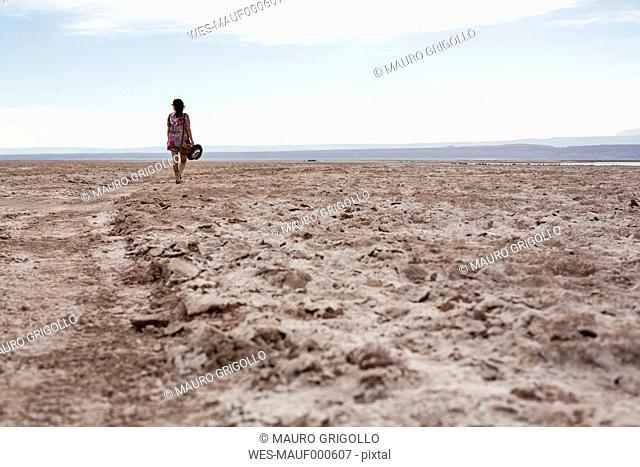 Chile, San Pedro de Atacama, woman walking in the desert