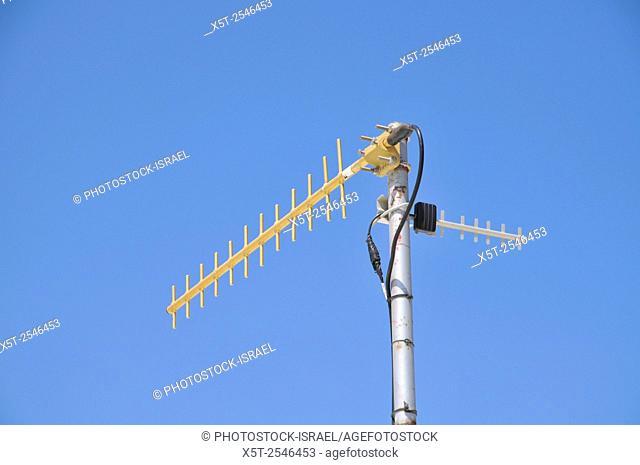 RF Antenna on blue sky background