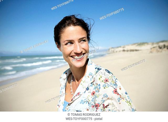 South Africa, portrait of smiling woman on the beach