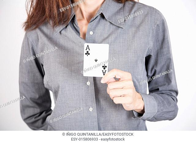 woman with grey shirt showing black clover ace card in her hands isolated over white background