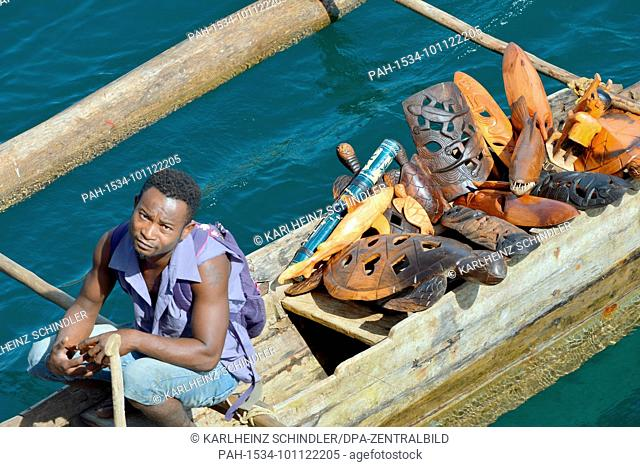18 January 2018, Madagascar, Andoany: Traders in traditional boats offering fruit and souvenirs to boats lying at anchor off Andoany