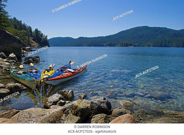 Kayaks docked on the shores of The Aquarium, in the heart of Desolation Sound near Powell River, British Columbia, Canada