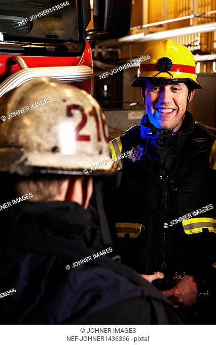 Two firefighters talking