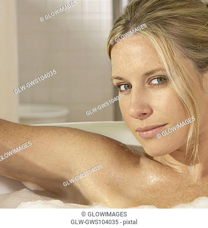 Portrait of a young woman in a bathtub