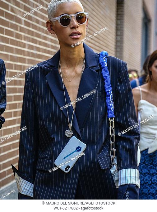 MILAN, Italy- September 20 2018: Model Janiece Dilone on the street during the Milan Fashion Week
