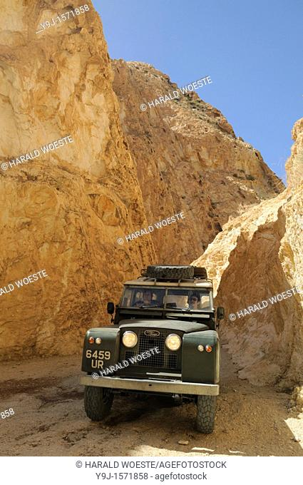 Africa, Tunisia, nr  Saket  Historic Land Rover Series 2a descending through the famous narrow gorge south of Saket