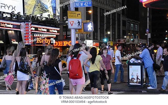 Crowd of people crossing the street, 42nd Street, Times Square, New York City, USA