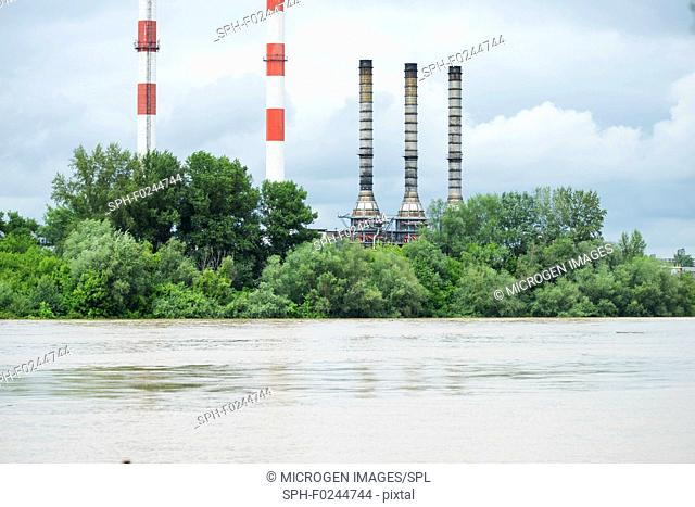 Flood waters threatening an industrial complex