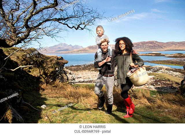 Family on walk, father carrying son on shoulders, Loch Eishort, Isle of Skye, Scotland